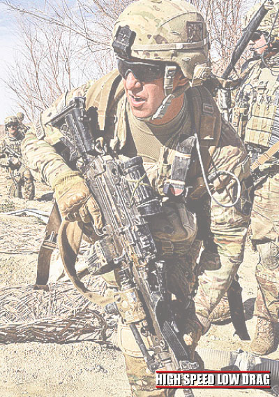 high speed low drag soldier holding a gun